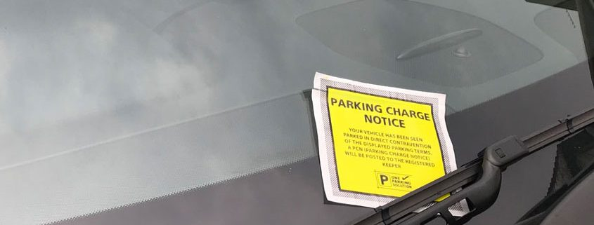 parking charge notice on a car windscreen