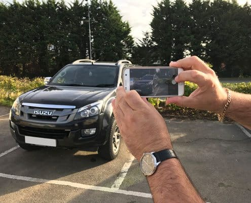 taking a picture of a vehicle